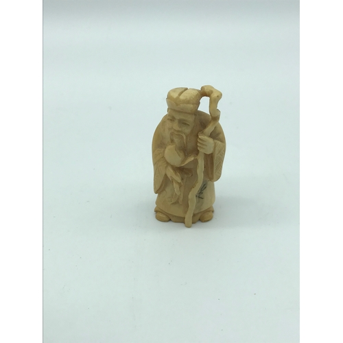 26 - An antique hand carved ivory netsuke of an old man with cane. Signed by the artist. possibly meiji p...