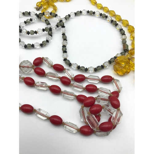 28 - A Lot of 3 vintage 1910/ 20's glass and bead necklaces. Includes Amber graduating glass bead necklac...