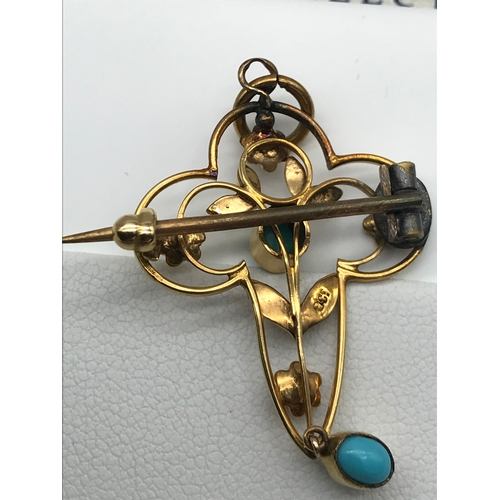 30 - A 9ct gold Art Nouveau pendant/ brooch set with 2 turquoise stones and seed pearls....