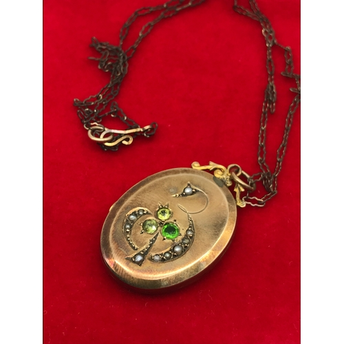 31 - A Victorian Gold locket set with seed pearls and 3 green stones. Comes with a vintage necklace. Lock...