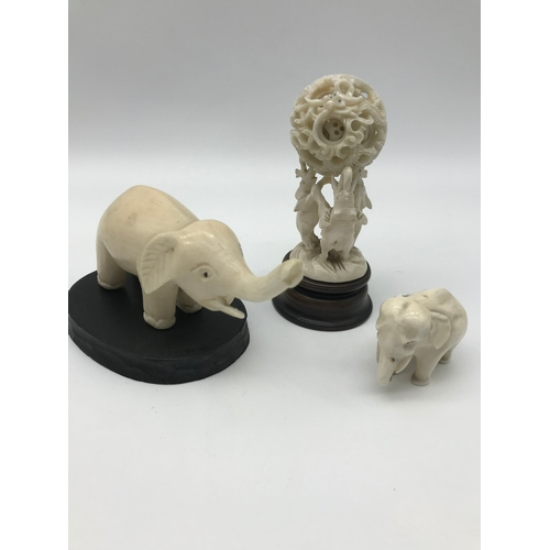 34 - A Lot of 3 early 1900's ivory carved elephant figures. One is designed with 3 elephants holding up a...