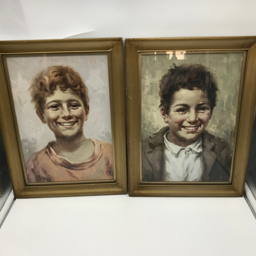 36 - Felix Vally (1866-1954) portraits of boys, one signed, Both oil paintings. Fitted within gilt frames...