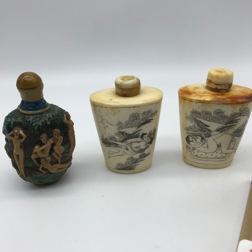 38 - A Lot of two carved bone perfume/ snuff bottles engraved with erotic oriental scenes, Modern resin b...