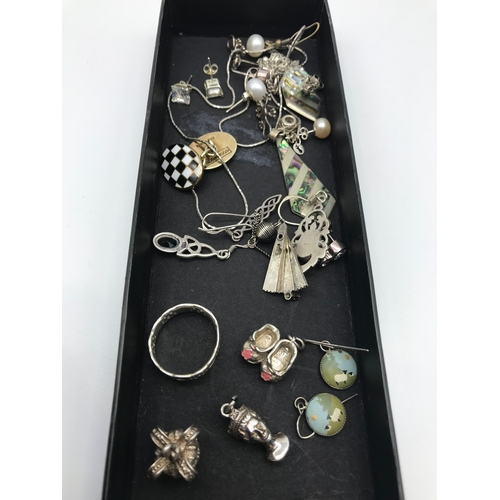 45 - A lot of silver jewellery which includes silver charms (Queens head) silver Girls academy viking shi...