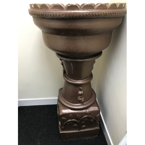 60a - A Large heavy brown glazed stone pedestal plant stand.110CM. 57CM IN DIAMETER...
