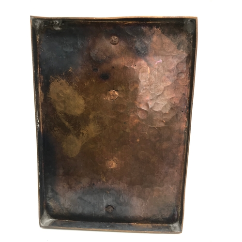 157 - An arts and craft hammered copper letter rack. Measures 9x12x8.5cm...