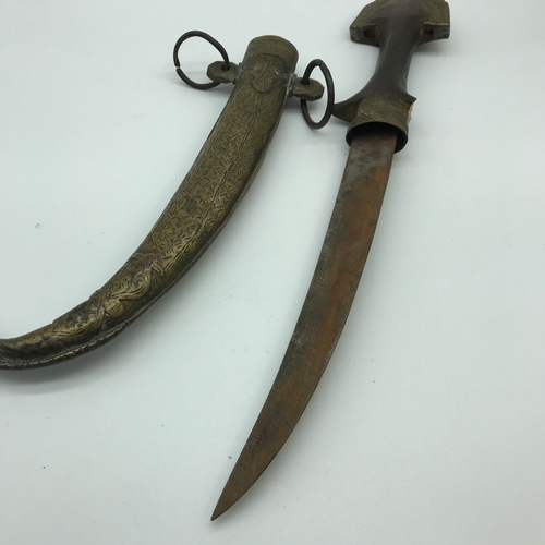 60 - Antique Arabic Moroccan dagger. Measures approx 40cm in length...