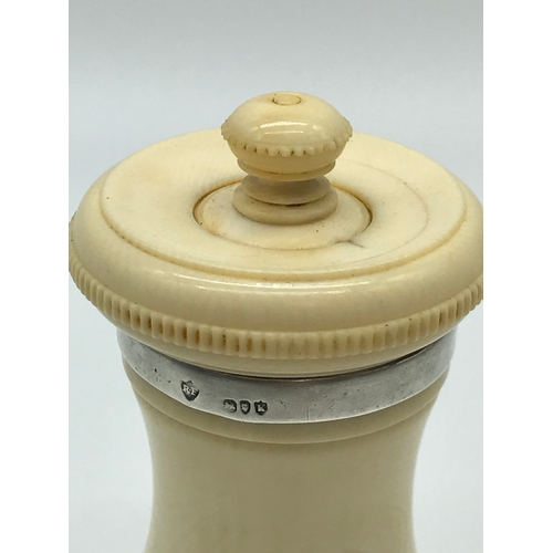 81 - A Victorian Ivory and silver mounted pepper grinder. Makers Rupert Favell and dated 1885. Measures 1...