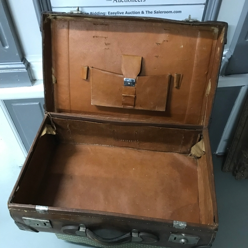 45A - A Vintage leather Williams & Compy heavy travel case....