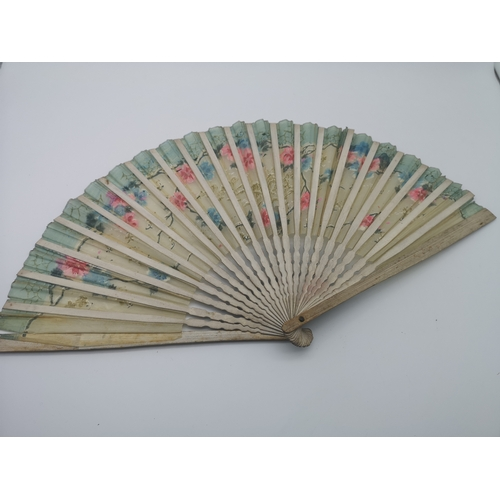 263 - A lot of four antique ornate fans, together with an art deco hair slide...