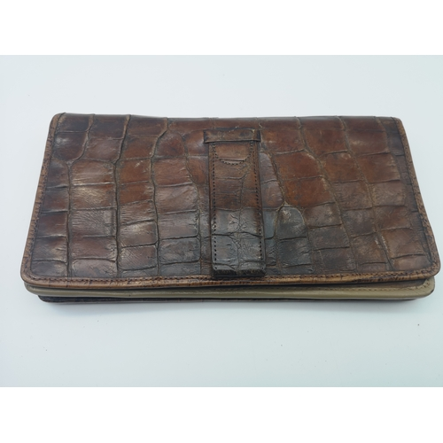265 - A snake skin wallet, three pairs of vintage gloves & a crocodile skin purse...