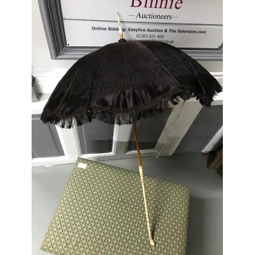 283 - A Lovely example of a Victorian parasol, silk material, Ivory turned handle and top....