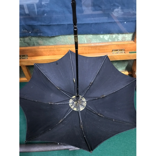 297 - Antique ladies parasol styled with wooden handle with red agate stone end, Makers Clark & Co Glasgow...