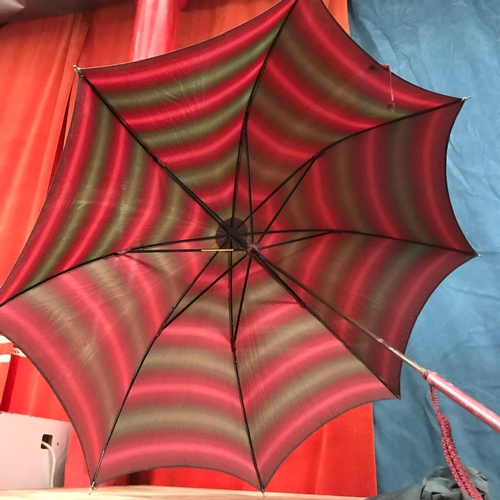 298 - Ladies antique parasol with red handle and butterscotch amber end. Made by Empire England. Green and...
