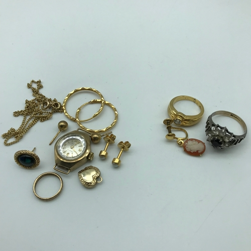 185 - A Lot of gold scrap jewellery which includes Avia 9ct gold cased watch, 9ct gold baby ring, 9ct gold...