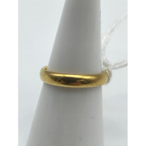 1 - A 22ct Gold wedding band, size M. 3.85Grams...