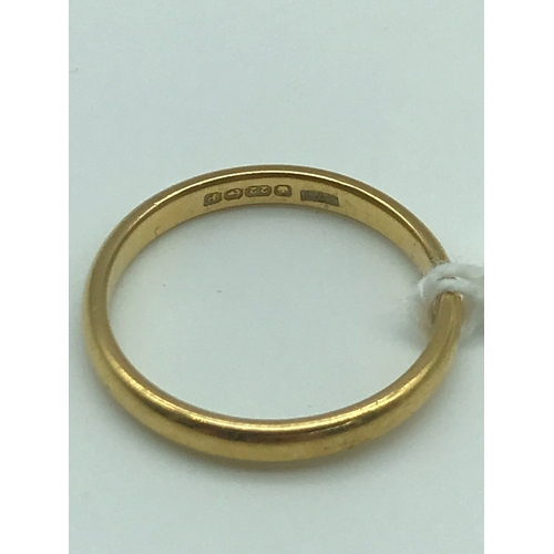 2 - A 22ct Gold wedding band, size O. Weighs 3.30grams...