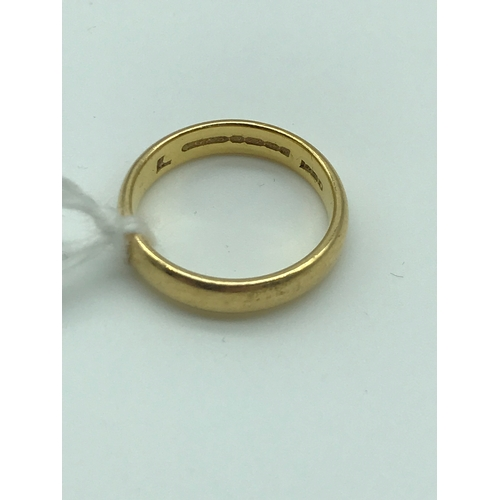 3 - A 22ct gold wedding band, size L. Weighs 5.07grams...