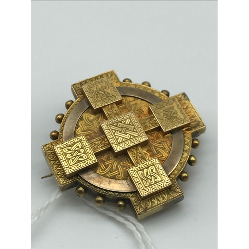5 - A Victorian Gold Celtic design Mourning brooch. Tested positive for gold. Weighs 14grams...