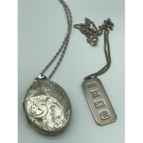 7 - Sheffield silver ornate engraved locket with silver chain together with Birmingham silver Ingot and ...