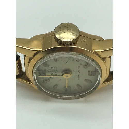9 - Vintage Swiss made MuDu ladies 18K Gold cased watch with gilt metal strap. 17 jewels. Non running....