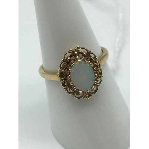 10 - A 9ct gold and large opal stone ring. Size O....