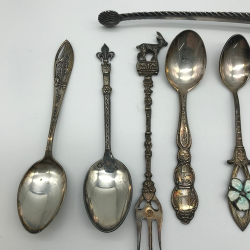 15 - A Selection of various 800 grade and sterling silver souvenir spoons, Together with ornate sugar ton...