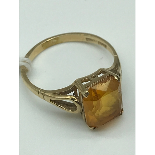 23 - A 9ct gold ladies ring set with a large square citrine stone....