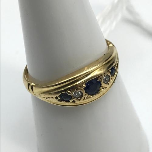 26 - 18ct gold 5 stone diamond & Sapphire ring. Size O...
