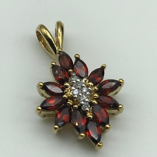 29 - Gold Pendant designed with diamonds and Garnets....