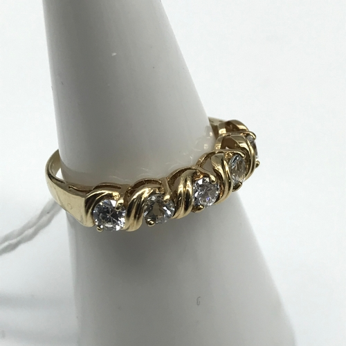 36 - A 9ct gold and CZ stone ring. Size M....