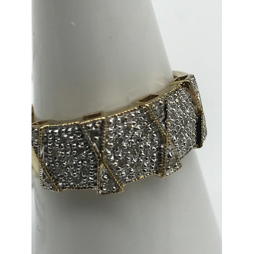 37 - A 9ct gold and diamond cluster ring. size L....