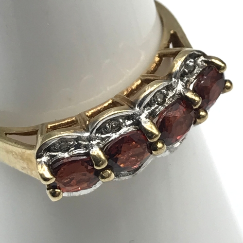 39 - A 9ct gold and Ruby set ring, Small diamonds to the sides. Size M....