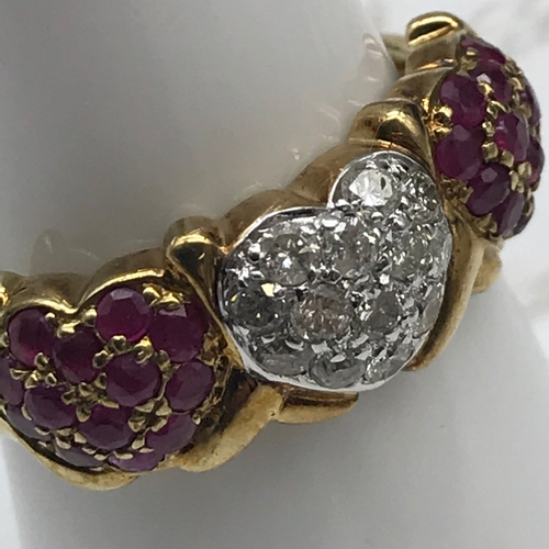 40 - A 9ct gold Diamond and Ruby cluster Heart shaped ring. Size L....