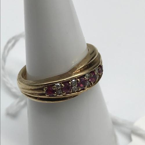 42 - 9ct gold Diamond & Ruby ring. Size L....