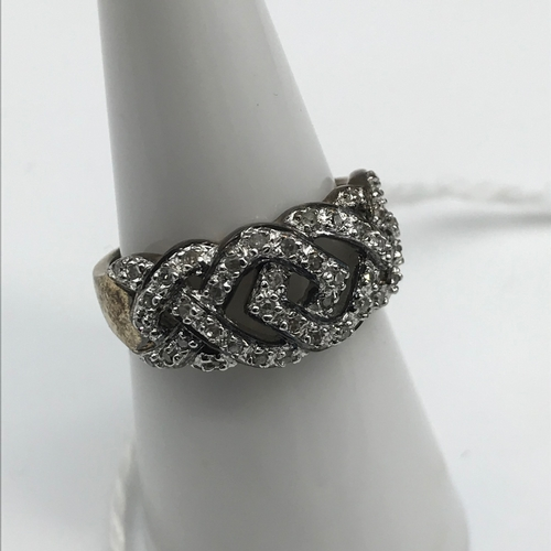 44 - A 9ct gold and diamond set ring. Size M....