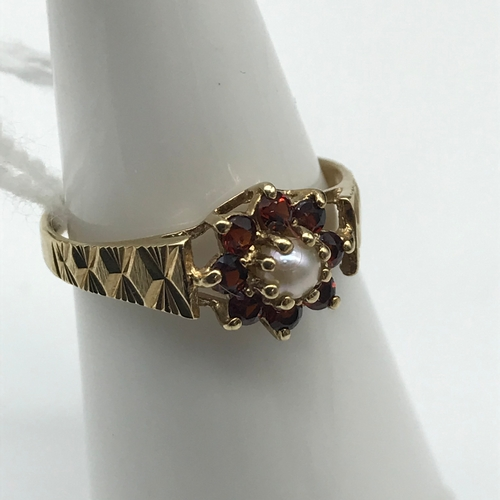 45 - A 9ct gold Single pearl and Garnet cluster ring. Size L....