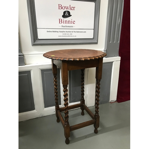 5a - A Solid oak window table, Styled with pie crust edge top and supported on barley twist legs, Measure...