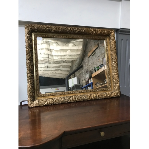 15a - A Heavy Antique gilt framed mirror, Measures 61x76cm...