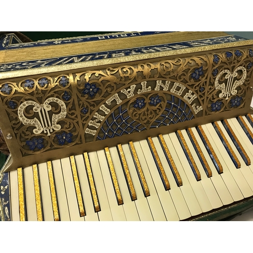 328 - Frontalini Piano Accordion 120 base, designed in a flamboyant blue mother of pearl design, Circa 192...