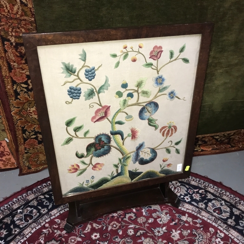 5a - Antique flip top table/ firescreen, designed with a floral tapestry behind glass. Table top measures...