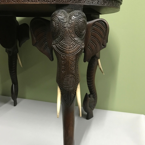 20a - Antique highly carved Indian table supported by carved elephant head legs with bone tusks, Carved wi...