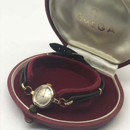 4 - A Ladies 9ct gold cased Omega wrist watch with red Omega case, In a working condition....