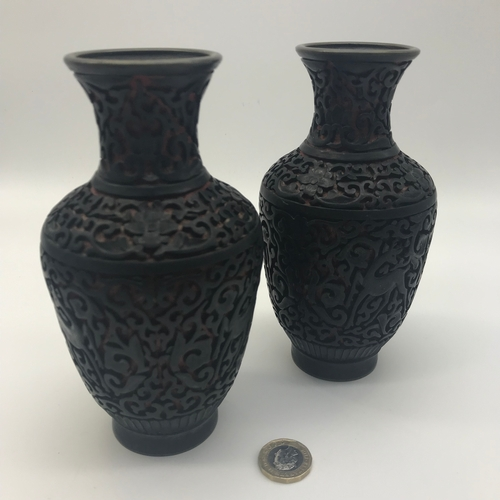 6 - A Pair of Antique Cinnabar carved vases. Measures 16.5cm in height...