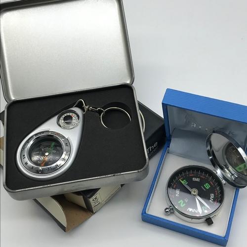 14 - 2 Modern pocket compasses...