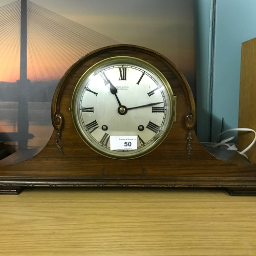 50 - Fully Functioning Mantel Clock with the name Hood and Son Dunfermline marked to the face...