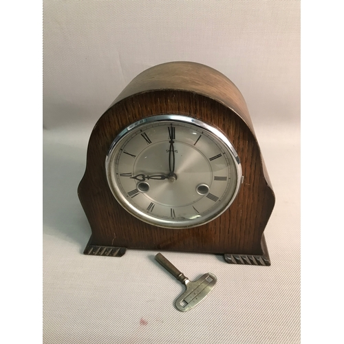92 - A vintage Smiths mantle clock, with key...
