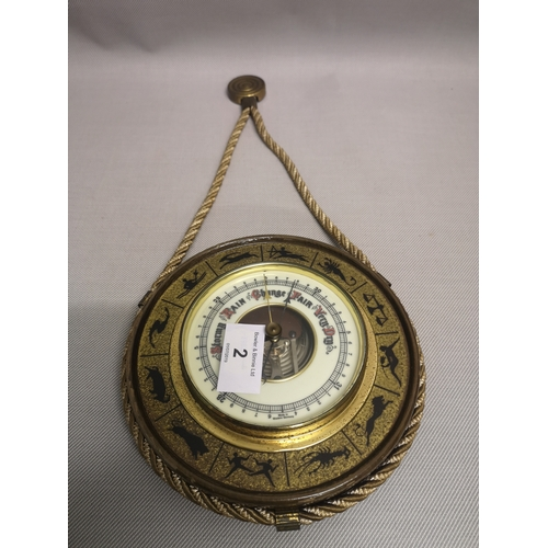 2 - A small wall hanging barometer depicting zodiac signs...