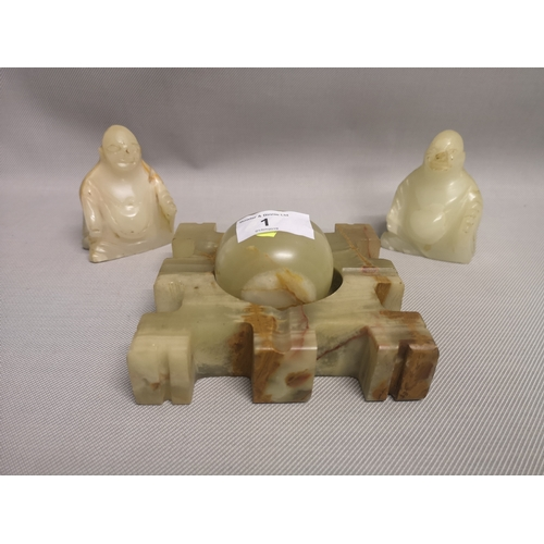 1 - A lot of two carved soapstone figurines, together with one other...