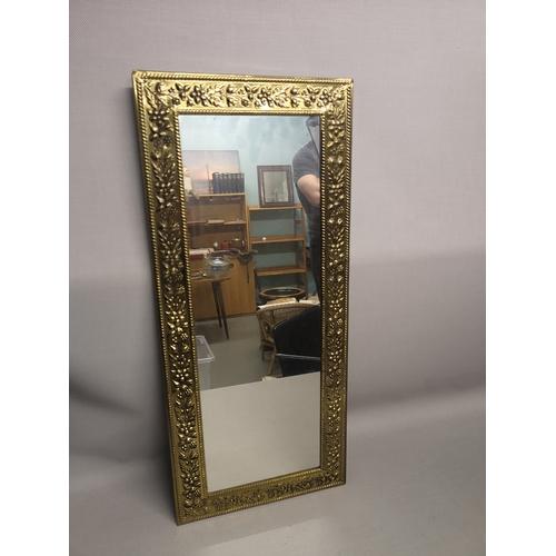 8 - A floral design gilt mirror...